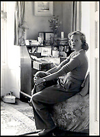 BNPS.co.uk (01202 558833)Pic: Rowley's/BNPS<br /> <br /> Daphne du Maurier in her study at Menabilly – 'my Mena' – which inspired the house Manderley in her famous novel Rebecca.<br /> <br /> Two previously unknown poems by celebrated writer Daphne du Maurier have been discovered hidden inside a photograph frame.<br /> <br /> They are believed to have been penned in the late 1920s, when she was in her early 20s and an unknown in the literary world.<br /> <br /> The poems were written on a carefully folded sheet of A4 paper concealed within a 5ins high blue leather frame which contained a photo of du Maurier in a swimming costume. <br /> <br /> They were uncovered by an eagle-eyed auctioneer who has been tasked with selling an archive of du Maurier's letters and photos, which includes snaps with the Royals.