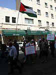 Palestinian and foreign activists hold Palestinian flags and slogans outside Damascus gate in Jerusalem's Old City, during a protest against land confiscation in the neighborhood of Sheikh Jarrah in the east Jerusalem on 18 May, 2012. Photo by Mahfouz Abu Turk