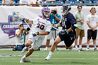 Noah Taylor (#20) works against Christian Cropp  (#34) as Yale defeats UAlbany 20-11 in the NCAAA semifinal game at Gillette Stadium, May 26.