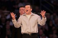 STATE COLLEGE, PA - FEBRUARY 8: Head coach Tom Brands of the Iowa Hawkeyes coaches during a match against the Penn State Nittany Lions on February 8, 2015 at the Bryce Jordan Center on the campus of Penn State University in State College, Pennsylvania. The Hawkeyes won 18-12. (Photo by Hunter Martin/Getty Images) *** Local Caption *** Tom Brands