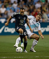 Landon Donovan (10) of the MLS All-Stars fights for the ball with Branislav Ivanovic (2) of Chelsea during the game at PPL Park in Chester, PA.  The MLS All-Stars defeated Chelsea, 3-2.