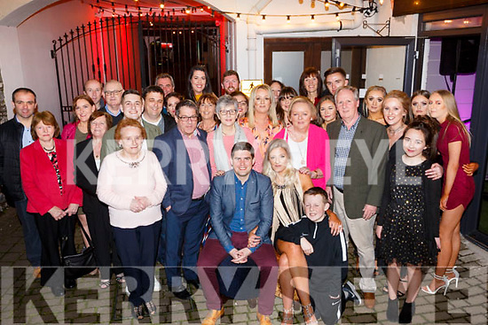 Shane Murphy and Stacey Wallace seated front centre celebrating their engagement party in Benners Hotel on Saturday night last with their family and friends.