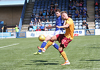 Lee Kilday comes across to block James Scott in the SPFL Betfred League Cup group match between Queen of the South and Motherwell at Palmerston Park, Dumfries on 13.7.19.