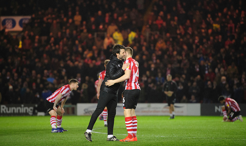 Lincoln City manager Danny Cowley, left, with Lincoln City's Harry Anderson prior to the game<br /> <br /> Photographer Chris Vaughan/CameraSport<br /> <br /> The EFL Sky Bet League Two - Lincoln City v Yeovil Town - Friday 8th March 2019 - Sincil Bank - Lincoln<br /> <br /> World Copyright © 2019 CameraSport. All rights reserved. 43 Linden Ave. Countesthorpe. Leicester. England. LE8 5PG - Tel: +44 (0) 116 277 4147 - admin@camerasport.com - www.camerasport.com