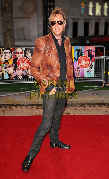 """RHYS IFANS.""""The Boat That Rocked"""" world film premiere at The Odeon, Leicester Square, London, England, UK,.23rd March 2009.full length brown shiny leather jacket grey gray jeans denim sunglasses shirt studded belt snakeskin hands in pockets .CAP/CAS.©Bob Cass/Capital Pictures"""
