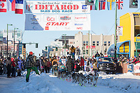 Michelle Phillips and team leave the ceremonial start line with an Iditarider and handler at 4th Avenue and D street in downtown Anchorage, Alaska on Saturday March 4th during the 2017 Iditarod race. Photo © 2017 by Brendan Smith/SchultzPhoto.com.