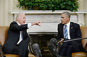 United States Vice President Joe Biden speaks as US President Barack Obama looks on while discussing the release of the Cancer Moonshot Report in the Oval Office of the White House on October 17, 2016 in Washington, DC. <br /> Credit: Olivier Douliery / Pool via CNP