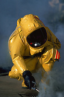 Hazardous materials. Firefighter with monitor checking environment