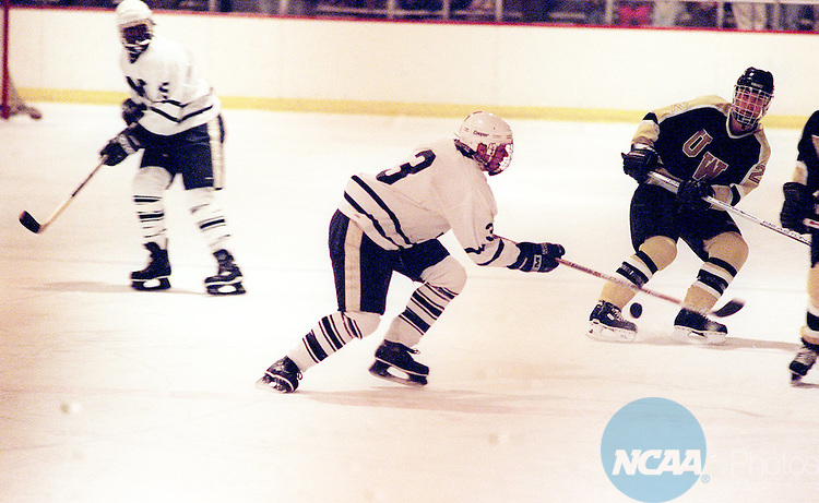 Caption: 22 MAR 1997: Middlebury forward Jim Walsh (33) tries to control the puck during the during the Division 3 Men's Hockey Championship held at Duke Nelson Arena in Middlebury, VT. Middlebury defeated Wisconsin 3-2 for the championship title. David Herskowitz/NCAA Photos.