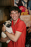 "Ugly Betty's Michael Urie at Broadway Barks 11 - a ""Pawpular"" star-studded dog and cat adopt-a-thon on July 11, 2009 in Shubert Alley, New York City, NY. (Photo by Sue Coflin/Max Photos)"
