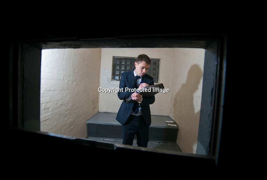 BNPS.co.uk (01202 558833)<br /> Pic: RachelAdams/BNPS<br /> <br /> Valuer Ed Impey in one of the cells. <br /> <br /> Potential buyers of this property that is for sale will hope to get it for a real steal.<br /> <br /> The three-storey building is actually a derelict police station that used to house scores of police officers and dozens of prisoners.<br /> <br /> The building used to serve as the main police station for Poole, Dorset, until 2009 when the force moved to a state-of-the-art HQ nearby.<br /> <br /> The 1930s building, that sits a 0.89 of an acre site, has lain mostly empty since then, at a cost of hundreds of thousands of pounds a year to the taxpayer.<br /> <br /> It is now gone on the market with interested parties invited to make sealed bids.