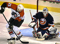 Philadelphia Flyers Keith Primeau (25) takes a backhad shot on New York Islanders goaltender Garth Snow (30), in the first period, Thursday, Dec. 6, 2001, in Philadelphia. Snow had 33 saves, as the Islanders defeated the Flyers 2-0. (Photo by William Thomas Cain/photodx.com)