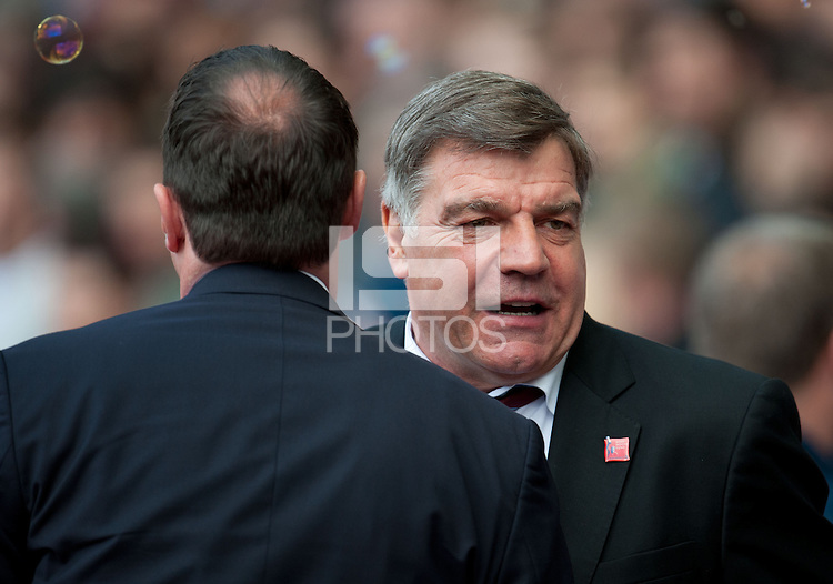 West Ham United manager Sam Allardyce shakes hands with Cardiff manager Malky Mackay.