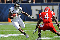 31 October 2009:  FIU running back Darriet Perry (28) attempts to evade Louisiana-Lafayette linebacker Daylon McCoy (4) in the first quarter of the FIU Golden Panthers victory over the Louisiana-Lafayette Ragin' Cajuns, 20-17, in overtime at FIU Stadium in Miami, Florida.