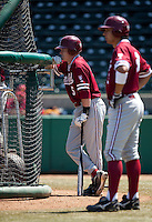 LOS ANGELES, CA - April 10, 2011: Zach Jones and Kenny Diekroeger of Stanford baseball watch batting practice before Stanford's game against USC at Dedeaux Field in Los Angeles. Stanford lost 6-2.