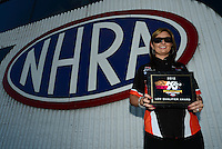 Sept 9, 2012; Clermont, IN, USA: NHRA pro stock driver Erica Enders poses for a photo with her top qualifier plaque prior to the US Nationals at Lucas Oil Raceway. Mandatory Credit: Mark J. Rebilas-