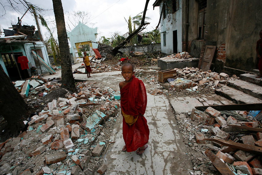A Burmese novice monk walks through the remains of the Gyo Gyi Monestary which was severely damaged by Cyclone Nargis in Piyapon (Irrawaddy Delta), Burma, Wednesday, May 7, 2008. Cyclone Nargis struck the Irrawaddy Delta region of Burma on May 4th/5th, leaving a path of destruction in its wake and killing approximately 130,000 people.