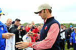 Dustin Johnson signs autographs on the 8th hole during Practice Day 3 of the The 2010 Ryder Cup at the Celtic Manor, Newport, Wales, 29th September 2010..(Picture Eoin Clarke/www.golffile.ie)