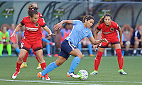Portland, Oregon - Saturday July 2, 2016: Sky Blue FC midfielder Raquel Rodriguez (11) dribbles away from Portland Thorns FC midfielder Meleana Shim (6) during a regular season National Women's Soccer League (NWSL) match at Providence Park.