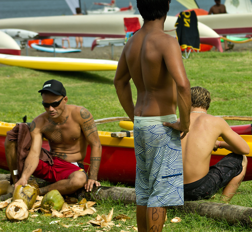 Cutting up coconuts at a canoe race in Hilo, Hawaii and Hawaiian Lifestyle covering the people, activities, location, culture, unique traditions, art, food and culture