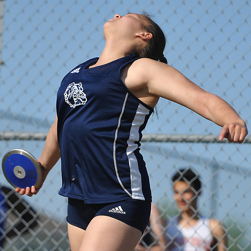 Kayley Ragazzini of Hewlett competes in the girls' discus throw after winning the girls' shot put event in the Nassau County AA track & field championship at MacArthur High School on Wednesday, May 23, 2018.
