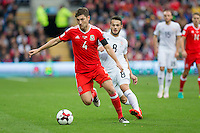 Ben Davies of Wales gets past Valeri Kazaishvili of Georgia during the FIFA World Cup Qualifier match between Wales and Georgia at the Cardiff City Stadium, Cardiff, Wales on 9 October 2016. Photo by Mark  Hawkins / PRiME Media Images.