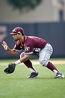 Texas A&M Aggies second baseman Andrew Collazo #6 prepares to field a grounder against the Texas Longhorns in NCAA Big XII Conference baseball on May 21, 2011 at Disch Falk Field in Austin, Texas. (Photo by Andrew Woolley / Four Seam Images)