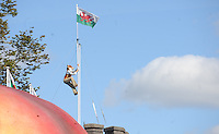 Pictured: Saturday 17 September 2016<br /> Re: Roald Dahl&rsquo;s City of the Unexpected has transformed Cardiff City Centre into a landmark celebration of Wales&rsquo; foremost storyteller, Roald Dahl, in the year which celebrates his centenary.<br /> Mr Fox climbs the flagpole on Cardiff Castle.