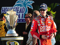 Nov. 16, 2008; Homestead, FL, USA; NASCAR Sprint Cup Series driver Carl Edwards walks by the championship trophy prior to the Ford 400 at Homestead Miami Speedway. Mandatory Credit: Mark J. Rebilas-