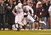 NWA Media/Michael Woods --11/01/2014-- w @NWAMICHAELW... Arkansas running back Alex Collins is tackled by Mississippi State defender Matt Wells in the 3rd quarter of Saturday nights game against Mississippi State at Davis Wade Stadium in Starkville, Mississippi.