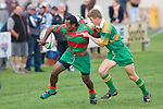 M. Topou flicks the ball on as he is tackled. Counties Manukau Premier Club Rugby round 5 game between Waiuku and Drury played at Waiuku on the 12th of May 2007. Waiuku led 33 - 0 at halftime and went on to win 57 - 5.