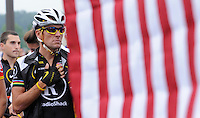 Cyclist Lance Armstrong listens tp the National Anthem prior to the start of his Livestrong Challenge 10K ride for cancer Sunday, august 22, 2010 in Blue Bell, Pa. (AP Photo/Bradley C Bower)