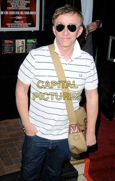 JASPER CONRAN .attending the gala screening of 'Boogie Woogie' at the Prince Charles Cinema, Leicester Square, London, England, UK, .April 13, 2010..half length blue and white striped polo shirt sunglasses ray bans aviators cross body bag Fred Perry t-shirt hand in pocket canvas khaki beige .CAP/CAN.©Can Nguyen/Capital Pictures.
