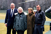 United States President George H.W. Bush, right, and first lady Barbara Bush, left center, welcome Chancellor Helmut Kohl of West Germany, left, and his wife, Hannelore, right center, to Camp David, the presidential retreat near Thurmont, Maryland on February 24, 1990.<br /> Credit: Ron Sachs / CNP