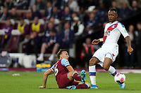 Jordan Ayew of Crystal Palace and Mark Noble of West Ham United during West Ham United vs Crystal Palace, Premier League Football at The London Stadium on 5th October 2019