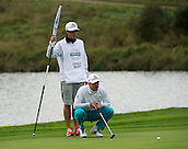 15.10.2014. The London Golf Club, Ash, England. The Volvo World Match Play Golf Championship.  Day 1 group stage matches.  Jonas Blixt [SWE] lines up a putt on the eighth green.