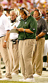 Landover, MD - August 19, 2006 -- New York Jets head coach Eric Mangini makes some notes during the preseason action against the  Washington Redskins at FedEx Field in Landover, Maryland, Saturday, August 19, 2006.<br />
