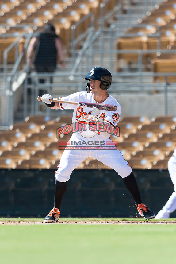 Glendale Desert Dogs third baseman Steve Wilkerson (12), of the Baltimore Orioles organization, shows bunt during an Arizona Fall League game against the Mesa Solar Sox at Camelback Ranch on October 15, 2018 in Glendale, Arizona. Mesa defeated Glendale 8-0. (Zachary Lucy/Four Seam Images)