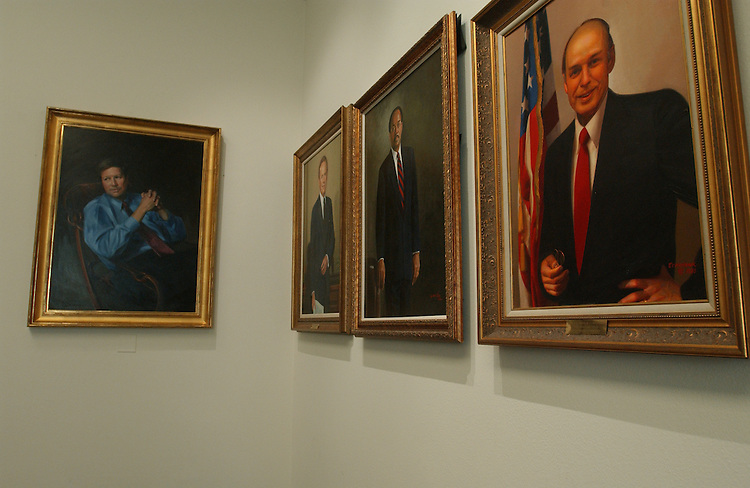 10/8/03.PAST HOUSE BUDGET CHAIRMEN--Portraits of past House Budget chairmen hang in the cloakroom, the room behind the dias of the committee's meeting room. Left to right: John Kasich, R-Ohio, Brock Adams, D-Wash., Bill Gray, D-Pa., and Jim Jones, D-Okla. (The portrait of Martin Sabo, D-Minn., is temporarily on display elsewhere.).CONGRESSIONAL QUARTERLY PHOTO BY SCOTT J. FERRELL