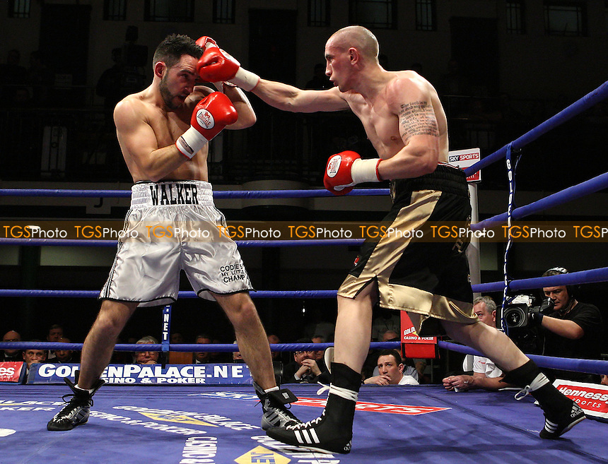 David Walker (Bermondsey, grey shorts) defeats Andy Butlin (Huddersfield, black shorts) in a Welterweight contest at York Hall, promoted by Hennessy Sports - 22/02/08 - MANDATORY CREDIT: Gavin Ellis/TGSPHOTO. Self-Billing applies where appropriate. NO UNPAID USE. Tel: 0845 094 6026
