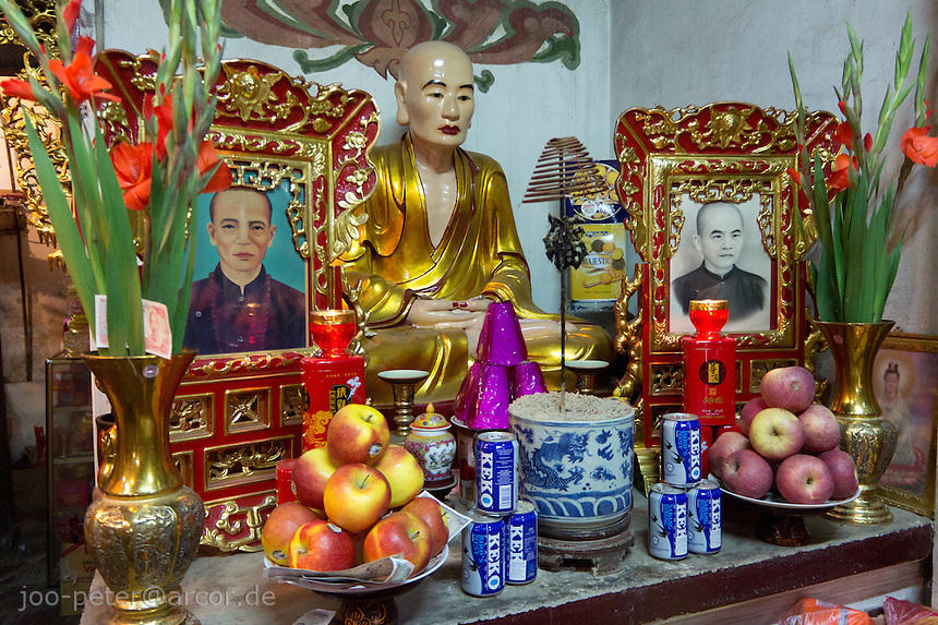 shrine with offerings in a temple in hanoi, Vietnam. Vietnamese belief is a blend of Buddhism, Taoism and animism.