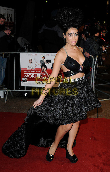 SOFIA HAYAT .UK Premiere of 'Morning Glory' at the Empire, Leicester Square, London, England, UK, January 11th 2011..full length black dress long maxi train ruffles cut out bra platform shoes shiny silver straps away wedges diamante .CAP/CAN.©Can Nguyen/Capital Pictures.