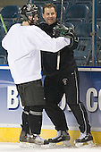 Taylor Chorney and Brad Berry - Berry had just scored against Walski - The University of North Dakota Fighting Sioux practice on Wednesday, April 5, 2006, at the Bradley Center in Milwaukee, Wisconsin prior to taking on Boston College in the 2006 Frozen Four Semi-Final the following day.