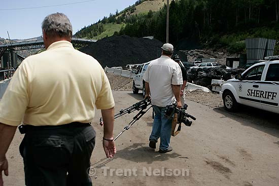 Huntington - Robert Murray, president and CEO of Ohio-based Murray Energy Corp, led reporters on a tour of the Crandall Canyon coal mine Wednesday, where six miners remained trapped. emery county sheriff lamar guymon escorts KSL photographer away from the tour