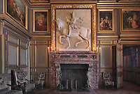 Relief of Henri IV, 1553-1610, on horseback, 1600-01, by Jacquet Mathieu, 1545-1611, on the Belle Cheminee in the Grands Appartements, Chateau de Fontainebleau, France. The Palace of Fontainebleau is one of the largest French royal palaces and was begun in the early 16th century for Francois I. It was listed as a UNESCO World Heritage Site in 1981. Picture by Manuel Cohen