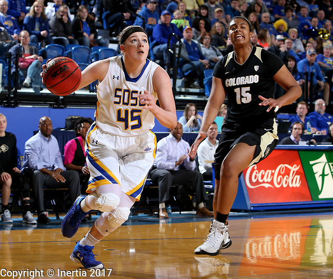 BROOKINGS, SD - MARCH 19:  Ellie Thompson #45 from South Dakota State drives past Zoe Correal #15 from Colorado during their second round WNIT game at Frost Arena March 19, 2017 in Brookings, South Dakota. (Photo by Dave Eggen/Inertia)