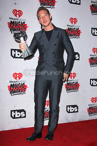 INGLEWOOD, CA - APRIL 3: Diplo in the press room at the iHeartRadio Music Awards at The Forum on April 3, 2016 in Inglewood, California. Credit: David Edwards/MediaPunch