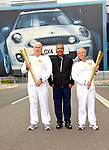 Paul Kelsey, daley thompson and nigel roberts at the Olympic Torch Relay at MINI Plant Oxford on Monday 9th July 2012  Picture By: Brian Jordan / Retna Pictures.. ..-..