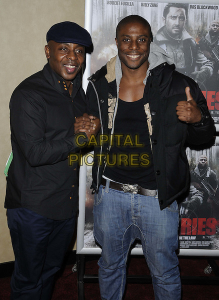 "Vas Blackwood & Leo Ihenacho.The ""Mercenaries"" UK film premiere, Empire cinema, Leicester Square, London, England..January 23rd, 2012.half length black puffa jacket shirt flat cap hat holding shaking hands.CAP/CAN.©Can Nguyen/Capital Pictures."