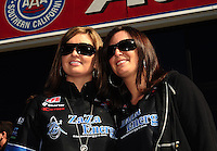 Feb. 27, 2011; Pomona, CA, USA; NHRA pro stock driver Erica Enders (left) with sister Courtney Enders during the Winternationals at Auto Club Raceway at Pomona. Mandatory Credit: Mark J. Rebilas-.
